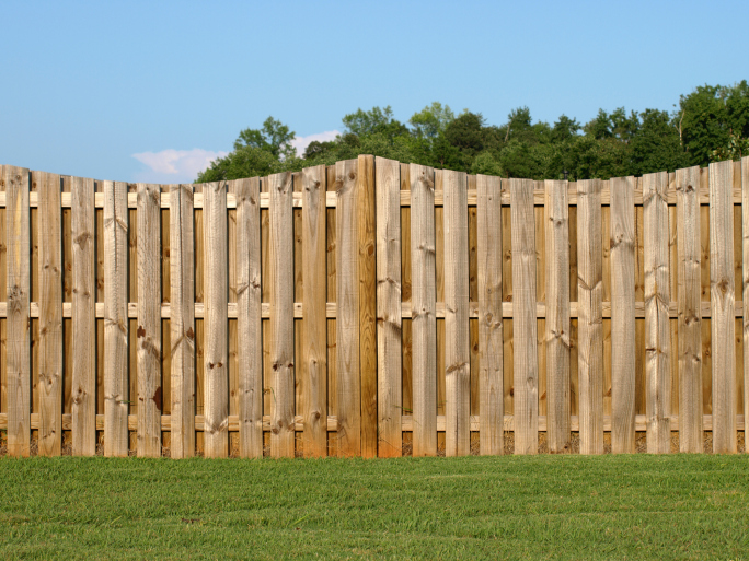 Improve Your Home's Resale Value with Our Guide to Adding a Beautiful Wooden Fence to Your Yard